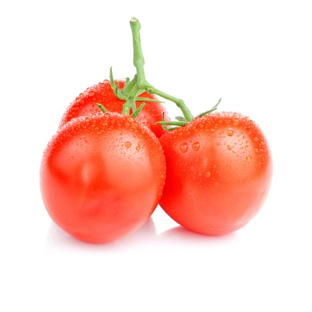 Three Vine fresh juicy tomato with water droplets Isolated on white background photo