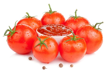 Bowl with fresh ketchup and six wet juicy ripe tomatoes isolated on white background