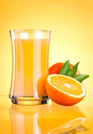 produce energy: Glass of Fresh Orange juice on yellow background Stock Photo