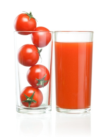 bloody mary: Cherry tomatoes inside of a glass and tomato juice
