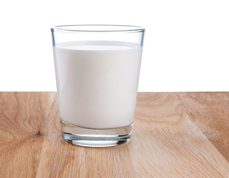 Glass of fresh milk is wooden table Isolated on white background photo