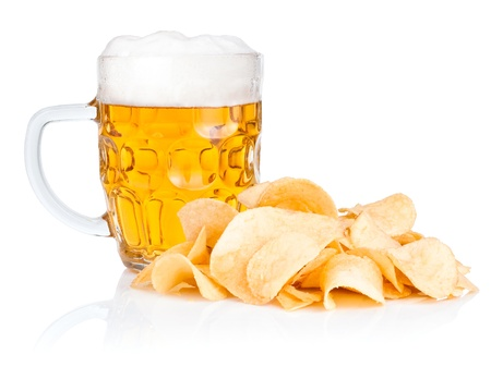 Fresh beer Mug with foam and Pile of potato chips Isolated on white background photo