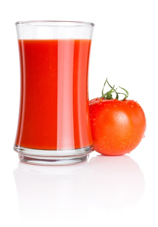 Glass of fresh tomato juice and tomatoes with water droplets Isolated on white background photo