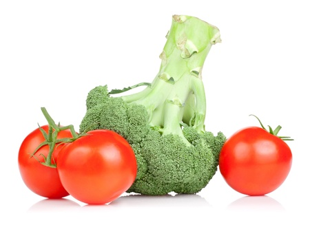 Fresh Broccoli and three red juicy tomato Isolated on white background photo