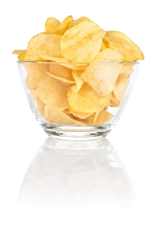 aliments: Glass bowl of with Pile potato chips on a white background