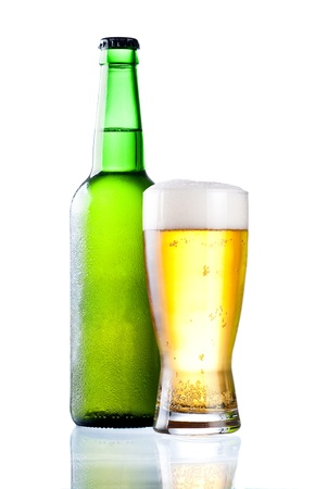 condensate: Chilled green bottle with condensate and a glass of beer lager on Isolated white background