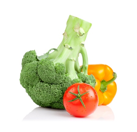 Broccoli, tomato and Yellow Bell Pepper isolated on white background photo