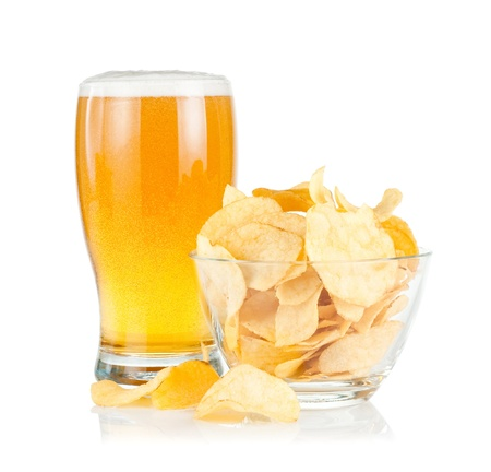 Glass of Fresh Beer and bowl of with Pile potato chips on a white background