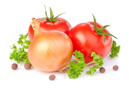 Two red tomatoes, bulbs of onion, parsley and Allspice isolated on a white background