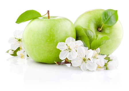 Two Green Apples with Leaf and Flowers isolated on a white background