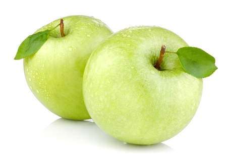 Two green apples with leaves and drops of water isolated on a white background photo