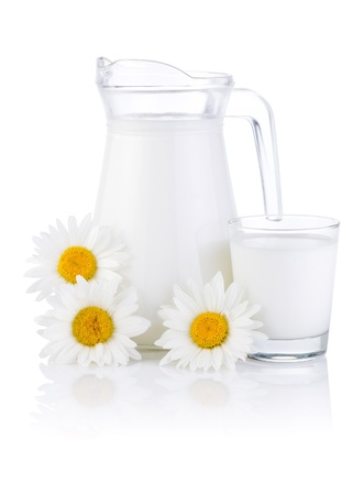 milk jug: Jug fresh milk, glass and three chamomile flowers isolated on white background