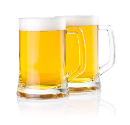 overflow: Two glasses of fresh beer with foam isolated on white background Stock Photo