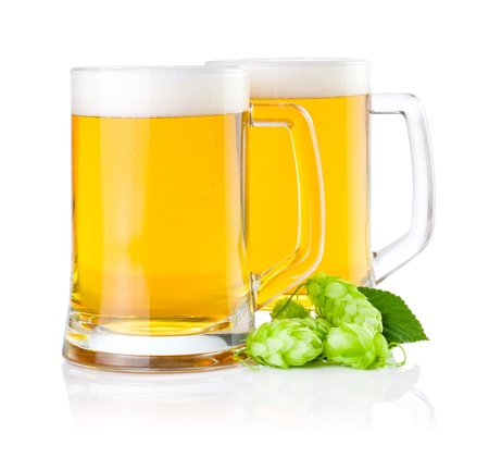 Two glasses of fresh beer with Green hops isolated on a white background photo