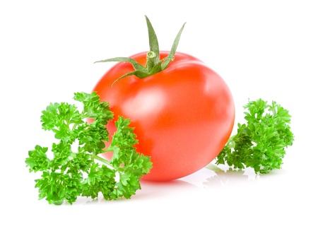 Fresh Juicy Tomato and parsley isolated on white background photo