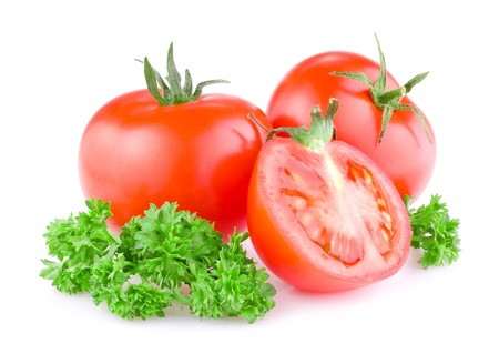 produce sections: Two Fresh Juicy tomato cut in half and a sprig of parsley Isolated on white background Stock Photo