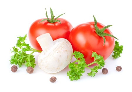 Two red tomatoes, fresh button mushrooms, parsley and allspice isolated on white background
