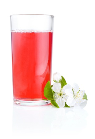 Glass of cherry juice and flowers isolated on white background photo
