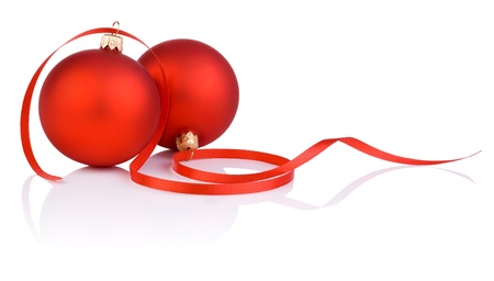 Two red christmas balls and tape Isolated on white background Фото со стока
