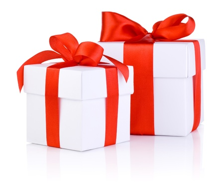 Two White boxs tied with a red satin ribbon bow Isolated on white background Banco de Imagens