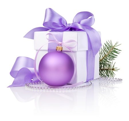 Christmas gift with Purple Ball, tree branch and ribbon bow isolated on white background photo