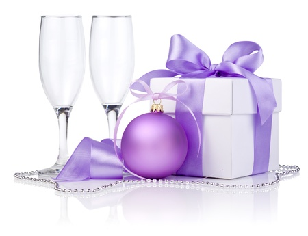 christmas beads: Christmas gift with Purple Ball, two empty champagne glass and ribbon bow isolated on white background