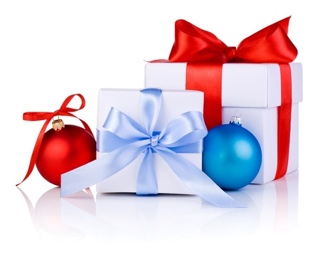 Two White boxs tied with a satin ribbon bow, red and blue Christmas balls Isolated on white background photo
