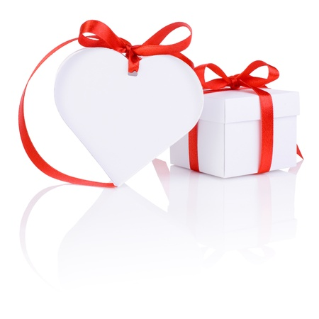 saint valentines day: Valentines Day gift in white box and heart red ribbon isolated on white