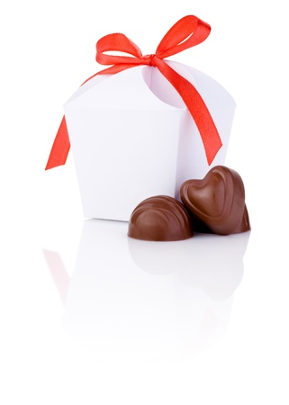 bonbonniere: Two hearts chocolate and White gift box with a bow of red ribbon Isolated on white background