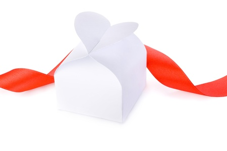 bonbonniere: White gift box with a clasp in the form of heart and red ribbon Isolated on white background