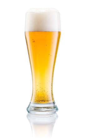 overflowing: Glass of fresh beer with cap of foam isolated on white background