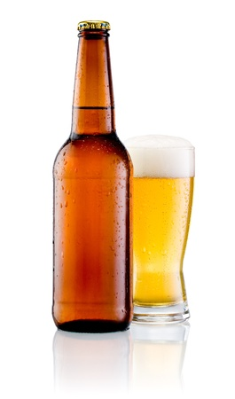 Brown bottle with drops and Glass of beer isolated on a white background photo