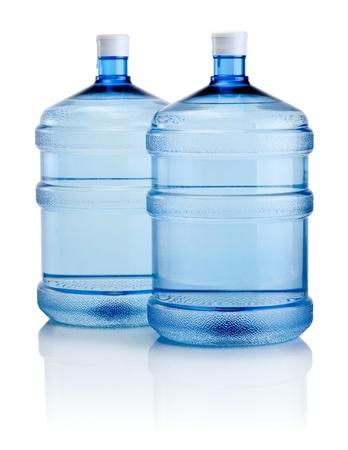 purified water: Dos grandes botellas de agua aislado en un fondo blanco Foto de archivo