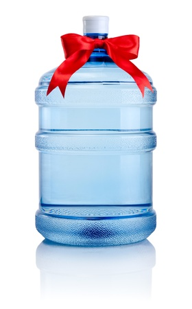 Big bottle of water tied with a red satin ribbon bow Isolated on white background photo