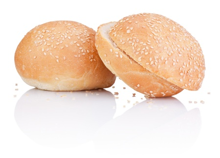 Two sandwich bun with sesame seeds cut isolated on white background photo