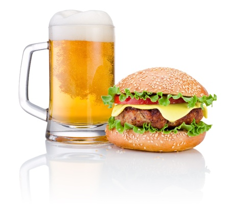Hamburger and Mug of beer isolated on white background photo