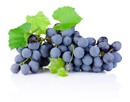 grapes on vine: Fresh bunch of grapes with leaves isolated on a white background