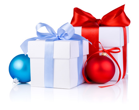 Two White boxs tied with a satin ribbon bow, red and blue Christmas balls Isolated on white background Stock Photo