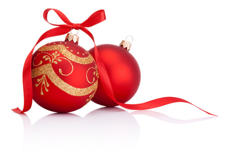 Two Red christmas decoration balls with ribbon bow isolated on white background Stok Fotoğraf