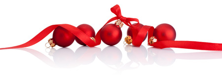 Red Christmas balls with ribbon bow Isolated on white background Фото со стока