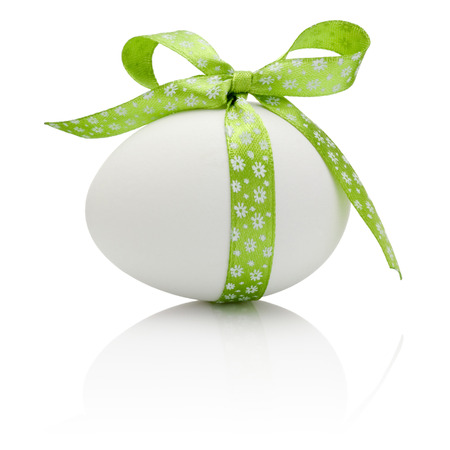 donative: Easter egg with festive green bow isolated on white background