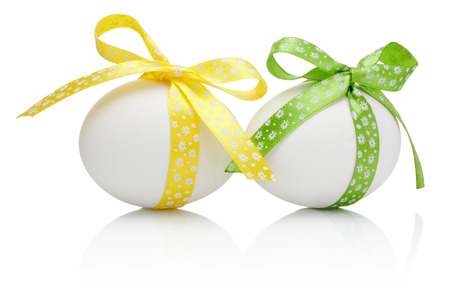 Three Easter eggs with festive bow isolated on white background photo