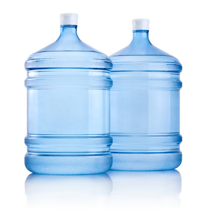 Two big bottles of water isolated on white background photo
