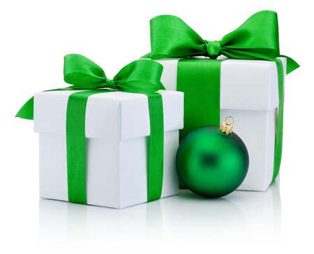 christmas fun: Two White boxs tied green satin ribbon bow and christmas ball Isolated on white background