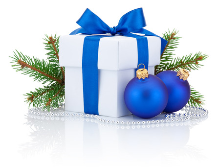 blue gift box: White box tied blue ribbon bow, pine tree branch and two christmas balls Isolated on white background