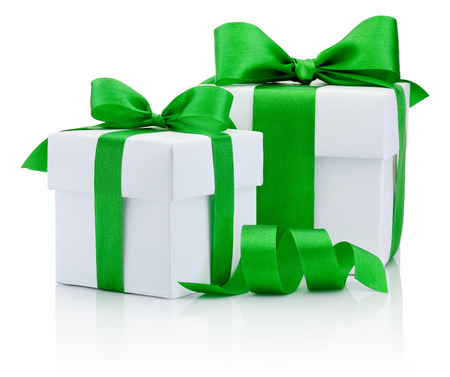 green: Two White boxs tied green ribbon bow Isolated on white background