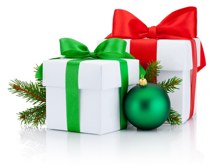 boxs: Two White boxs tied red and green ribbons bow, pine tree branch and christmas ball Isolated on white background