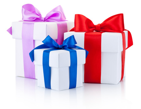 three gift boxes: Three White boxs tied with colored satin ribbons bow Isolated on white background