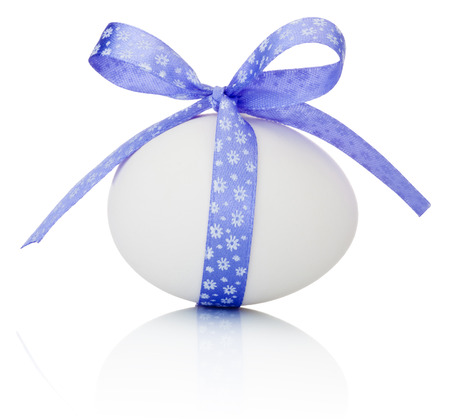 Easter egg with festive purple bow isolated on white background photo