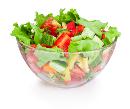 Fresh vegetable salad in glass bowl isolated on white background